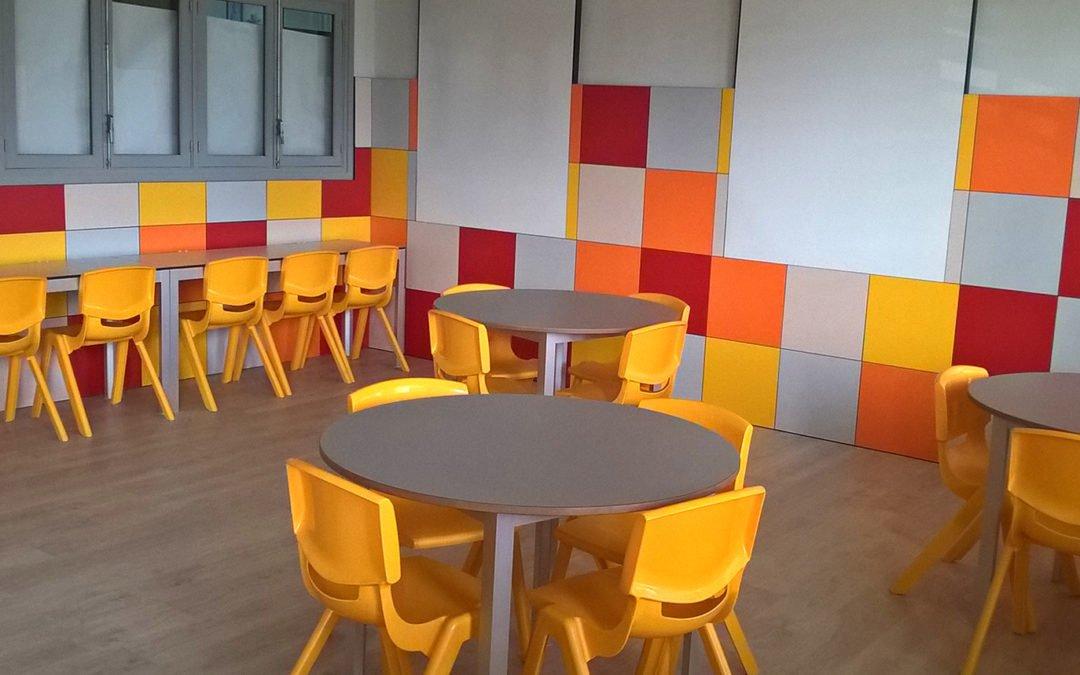 Revestimiento de paredes y pavimento en aulas Salesianos